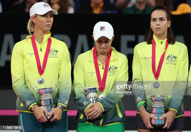 Alicia Molik, Ash Barty and Ajla Tomljanovic of Australia look on after being defeated in the 2019 Fed Cup Final tie between Australia and France at...