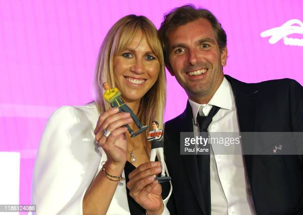 Alicia Molik Australia Fed Cup Captain and Julien Benneteau France Fed Cup Captain pose with miniature replicas of themselves during the 2019 Fed Cup...