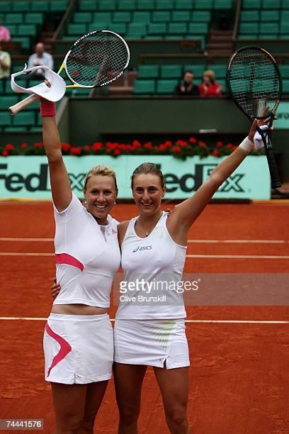 Alicia Molik of Australia and Mara Santangelo of Italy celebrate winning against Katarina Srebotnik of Slovenia and Ai Sugiyama of Japan in the...