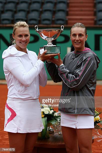 Alicia Molik of Australia and Mara Santangelo of Italy pose with the trophy after winning against Katarina Srebotnik of Slovenia and Ai Sugiyama of...