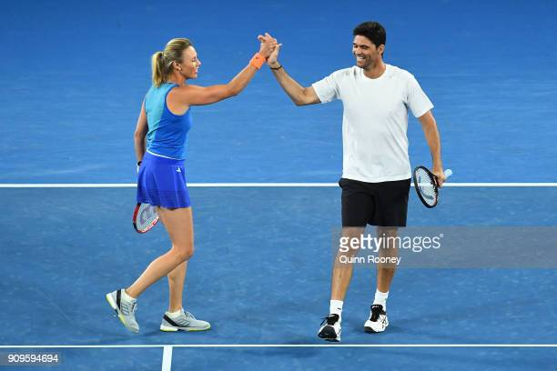 Alicia Molik of Australia and Mark Philippoussis of Australia compete in their mixed doubles match against Goran Ivanisevic of Croatia and Daniela...