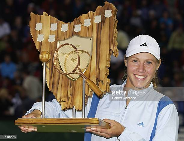Alicia Molik of Australia celebrates with the winners trophy after defeating Amy Frazier of the USA in the final of the Moorilla International at the...