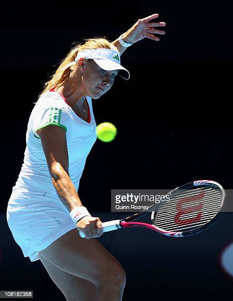 Alicia Molik of Australia plays a backhand in her second round match against against Nadia Petrova of Russia during day four of the 2011 Australian...