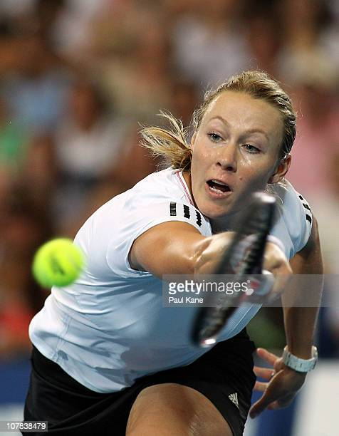 Alicia Molik of Australia plays a backhand shot during her singles match against Justine Henin of Belgium on day one of the Hopman Cup on January 1...