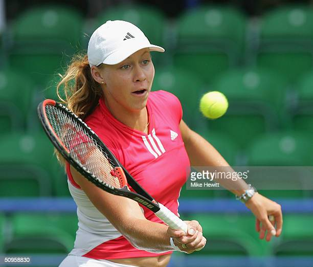 Alicia Molik of Australia plays a volley during her qualifying singles match against Shenay Perry of USA in the Hastings Direct International Tennis...