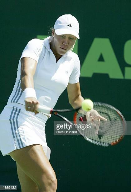 Alicia Molik of Australia returns a shot to Jelena Dokic of Yugoslavia during the Nasdaq100 Open March 24 2003 at the Tennis Center at Crandon Park...