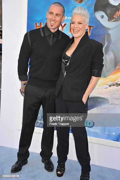 Alicia Moore and husband Carey Hart arrive at the world premiere of 'Happy Feet Two' held at Grauman's Chinese Theater in Hollywood
