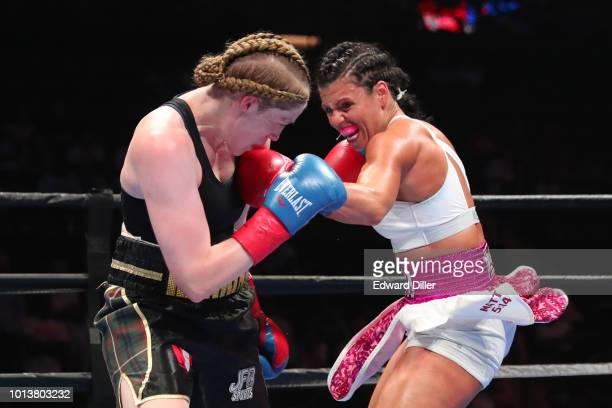 Alicia Napoleon of the United States throws a left hand against Hannah Rankin of Scotland Napoleon would win by unanimous decision to successfully...