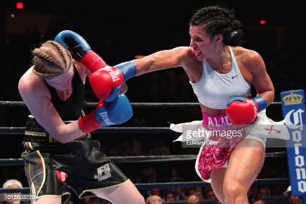 Alicia Napoleon of the United States throws a right hand against Hannah Rankin of Scotland Napoleon would win by unanimous decision to successfully...
