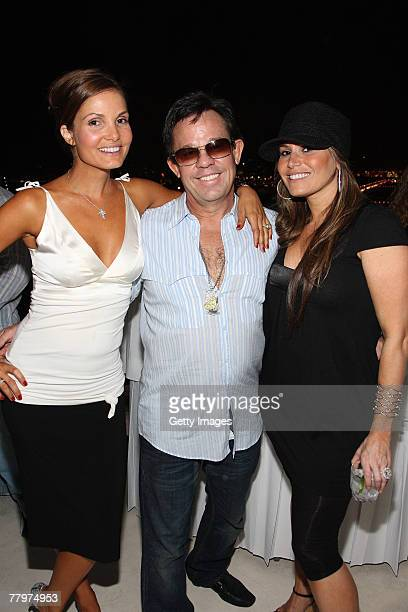 Alicia Piazza JR Ridinger Loren Ridinger pose at the Audemars Piguet cocktail reception at Mike Piazza's home on November 18 2007 in Miami Beach...