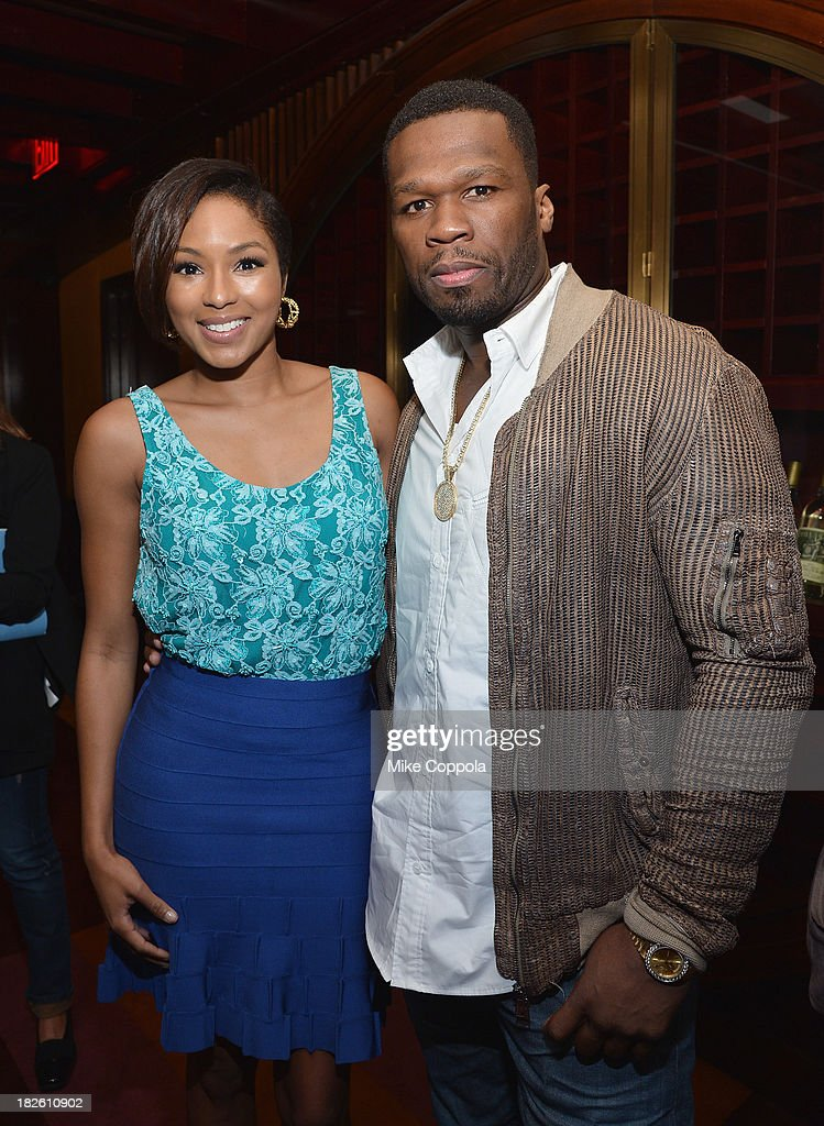 Alicia Quarles (L) and Curtis '50 Cent' Jackson pose for a picture before speaking on a panel on education in anticipation of the upcoming series 'Dream School' on October 1, 2013 in New York City.