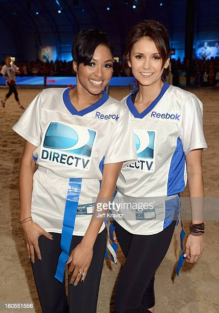Alicia Quarles and Nina Dobrev attend DIRECTV'S 7th Annual Celebrity Beach Bowl at DTV SuperFan Stadium at Mardi Gras World on February 2 2013 in New...