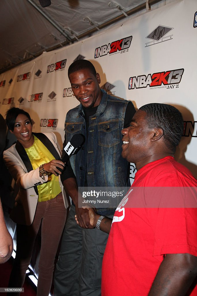 Alicia Quarles, Kevin Durant and Tracy Morgan attend The Premiere Of NBA 2K13 With Cover Athletes And NBA Superstars at 40 / 40 Club on September 26, 2012 in New York City.