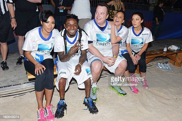 Alicia Quarles Lil Wayne Tom Arnold Christine Teigen and Leah Gibson attend DIRECTV'S Seventh Annual Celebrity Beach Bowl at DTV SuperFan Stadium at...