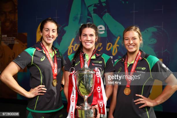 Alicia Quirk Charlotte Caslick and Emma Tonegato of the Australian Women's Sevens Squad pose following their 20172018 Sevens World Series victory at...