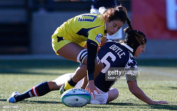Alicia Quirk of Australia battles for the ball against Lauren Doyle of the United States during the IRB Women's Sevens World Series at Fifth Third...