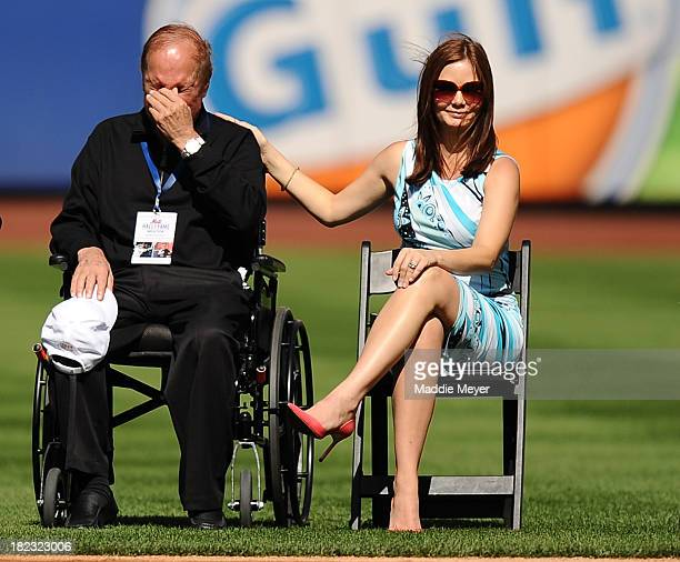 Alicia Rickter wife of Mike Piazza sits with his father Vince Piazza during Mike Piazza's induction to the Mets Hall of Fame at Citi Field on...