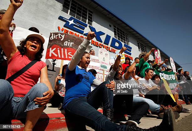 LOS ANGELES CA APRIL 14 2014 Alicia Rivera Maya Herrera and Carmen Garcia left to right chant as they join the groups Communities for a Better...