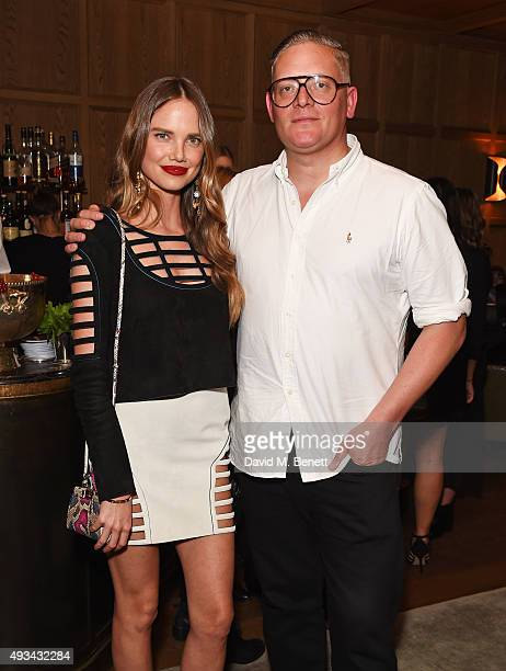Alicia Rountree and designer Giles Deacon attend a cocktail reception hosted by Giles Deacon to celebrate the launch of the Giles/EDITION collection...