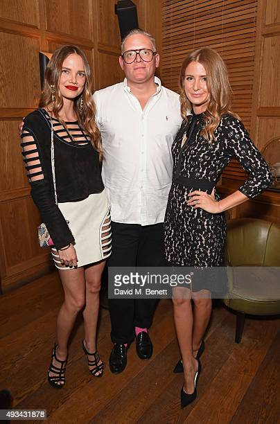Alicia Rountree designer Giles Deacon and Millie Mackintosh attend a cocktail reception hosted by Giles Deacon to celebrate the launch of the...