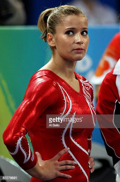 Alicia Sacramone of the United States reacts during the artistic gymnastics team event at the National Indoor Stadium during Day 5 of the Beijing...