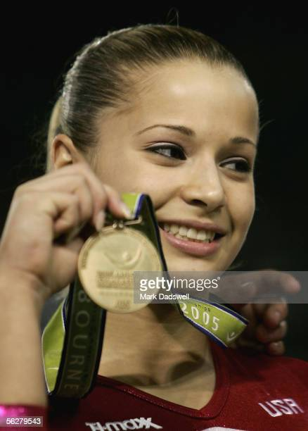 Alicia Sacramone of the USA celebrates winning the floor during the Apparatus Finals of the 2005 World Gymnastics Championships at Melbourne Park on...