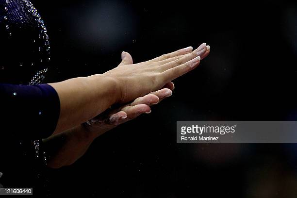 Alicia Sacramone puts chalk on her hands during the Senior Women's competition on day four of the Visa Gymnastics Championships at Xcel Energy Center...