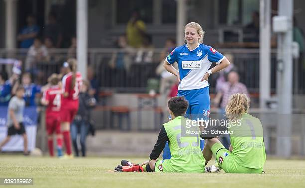 Alicia Schinko of 1899 Hoffenheim Charlotte Voll of 1899 Hoffenheim and Janina Leitzig of 1899 Hoffenheim are disappointed during the U17 girl's...