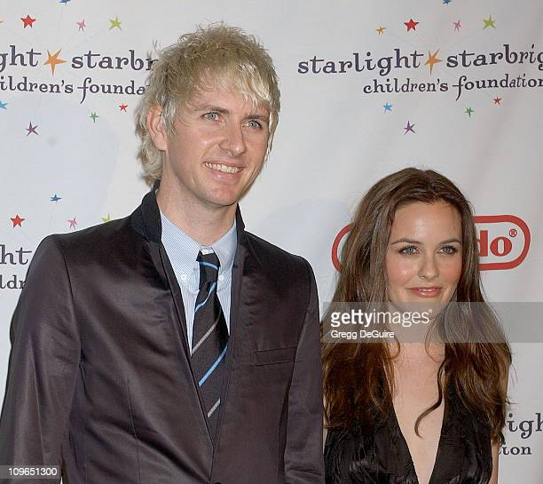 Alicia Silverstone and Chris Jarecki during Starlight Starbright Children's Foundation Honor Dakota Fanning at A Stellar Night Gala Arrivals at...