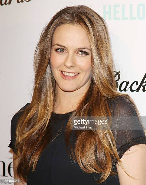 Alicia Silverstone arrives at the Los Angeles premiere of 'Ass Backwards' held at the Vista Theatre on October 30 2013 in Los Angeles California
