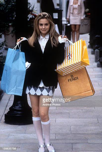 Alicia Silverstone holding shopping bags in a scene from the film 'Clueless' 1995