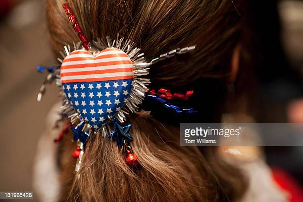 Alicia Smith of Herndon wears an American Flag brooch in her hair during the Fairfax County Republican Committee election party at the Fairview Park...