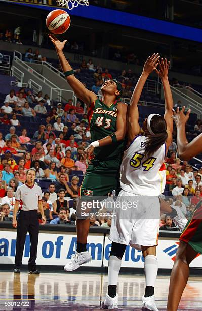 Alicia Thompson of Seattle Storm shoots against Plenette Pierson of the the Phoenix Mercury June 2 2005 at America West Arena in Phoenix Arizona NOTE...