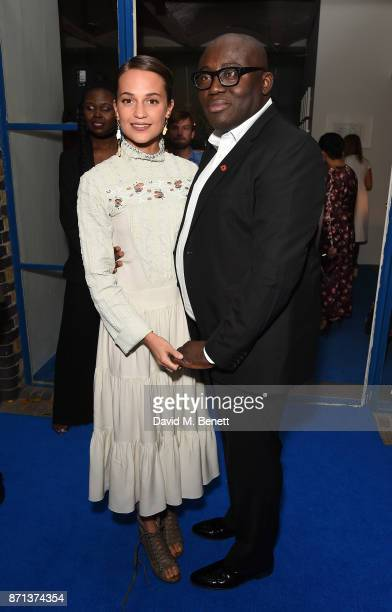 Alicia Vikander and Edward Enninful attend a dinner hosted by Jonathan Newhouse and Albert Read for Edward Enninful to celebrate the December issue...