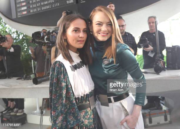 Alicia Vikander and Emma Stone attend the Louis Vuitton Cruise 2020 Fashion Show at JFK Airport on May 08, 2019 in New York City.