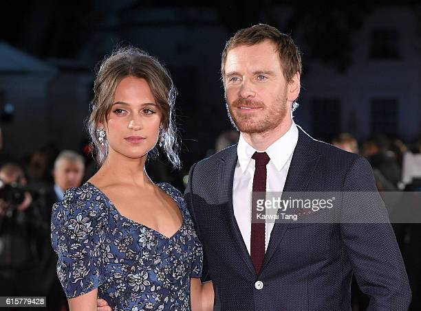 """Alicia Vikander and Michael Fassbender arrive for the UK premiere of """"The Light Between Oceans"""" at The Curzon Mayfair on October 19, 2016 in London,..."""
