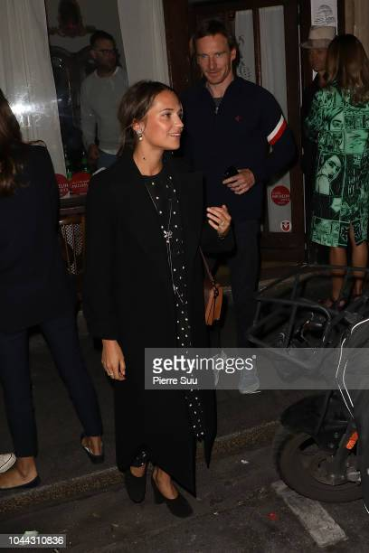Alicia Vikander and Michael Fassbender come out of a restaurant on October 1 2018 in Paris France