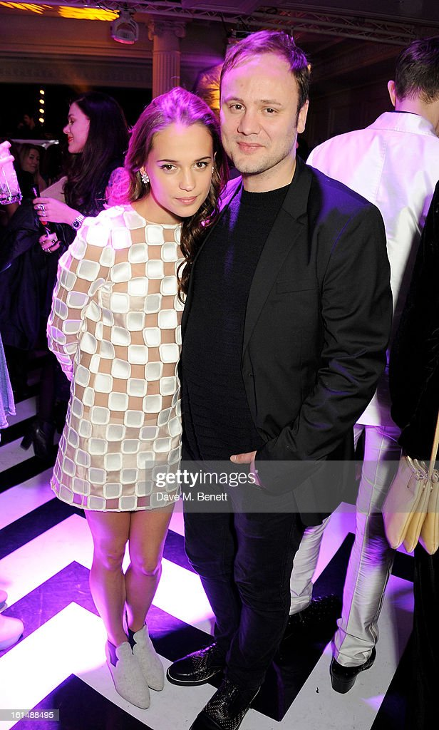 Alicia Vikander (L) and Nicholas Kirkwood attend the after party following the Elle Style Awards at The Savoy Hotel on February 11, 2013 in London, England.