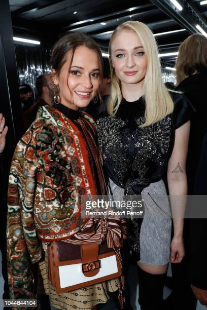 Alicia Vikander and Sophie Turner attend the Louis Vuitton show as part of the Paris Fashion Week Womenswear Spring/Summer 2019 on October 2 2018 in...