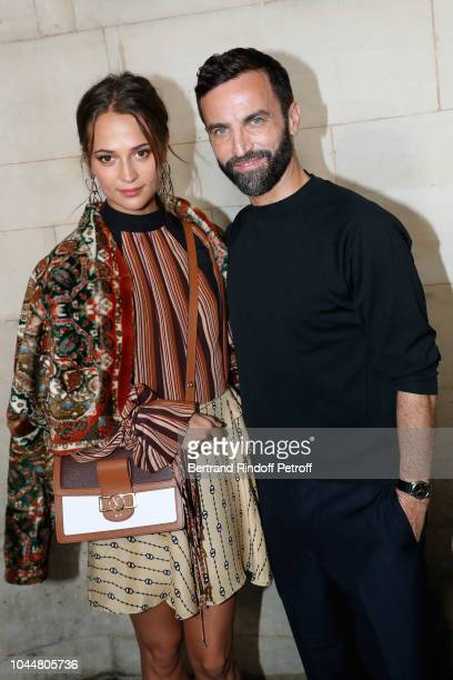 Alicia Vikander and Stylist Nicolas Ghesquiere pose after the Louis Vuitton show as part of the Paris Fashion Week Womenswear Spring/Summer 2019 on...