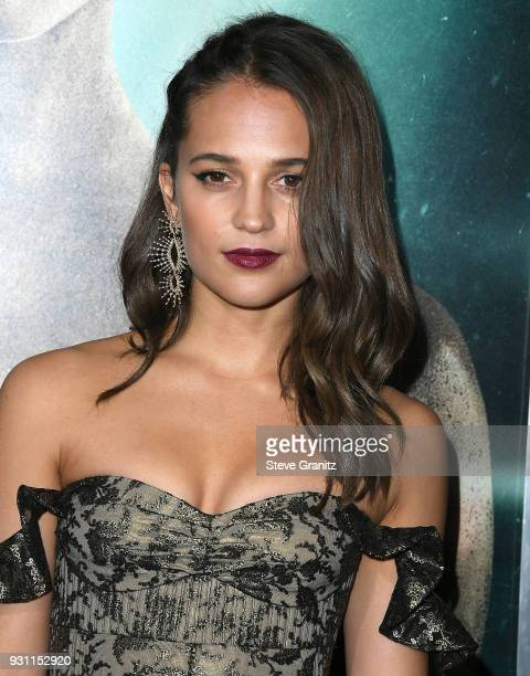 Alicia Vikander arrives at the Warner Bros Pictures 'Tomb Raider' Premiere at TCL Chinese Theatre IMAX on March 12 2018 in Hollywood California
