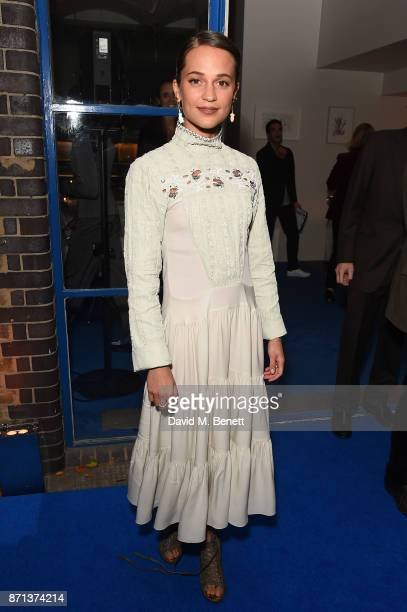 Alicia Vikander attends a dinner hosted by Jonathan Newhouse and Albert Read for Edward Enninful to celebrate the December issue of British Vogue at...