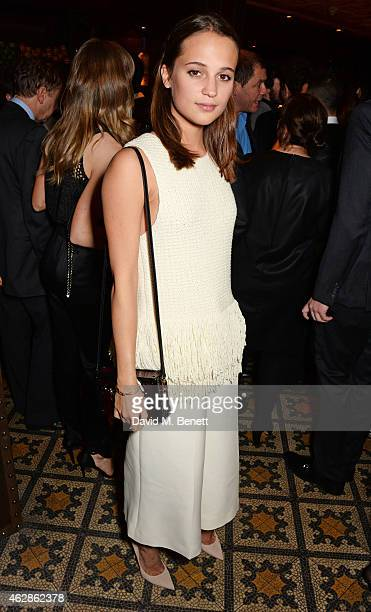 Alicia Vikander attends Harvey Weinstein's BAFTA Dinner in partnership with Burberry GREY GOOSE at Little House Mayfair on February 6 2015 in London...