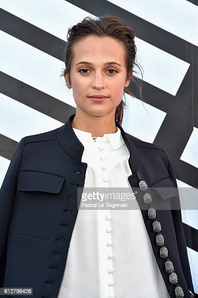 Alicia Vikander attends the Louis Vuitton show as part of the Paris Fashion Week Womenswear Spring/Summer 2017 on October 5 2016 in Paris France