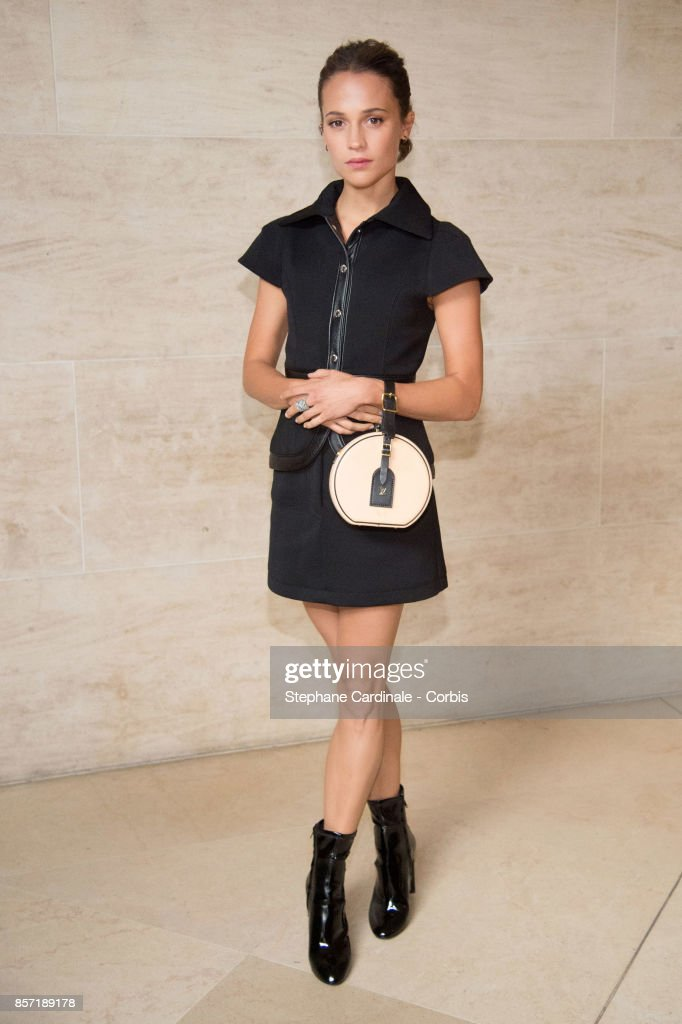 Alicia Vikander attends the Louis Vuitton show as part of the Paris Fashion Week Womenswear Spring/Summer 2018 at Musee du Louvre on October 3, 2017 in Paris, France.