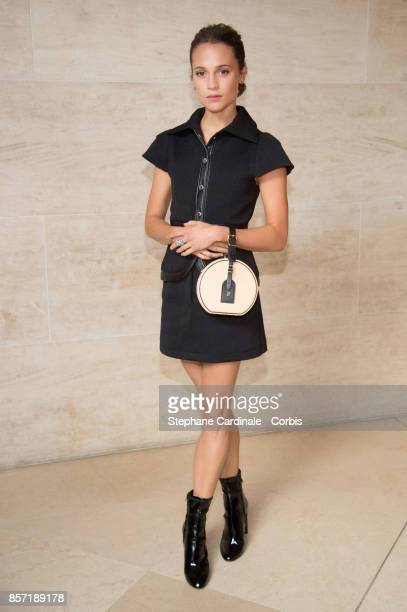 Alicia Vikander attends the Louis Vuitton show as part of the Paris Fashion Week Womenswear Spring/Summer 2018 at Musee du Louvre on October 3, 2017...