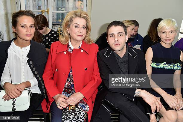 Alicia Vikander Catherine Deneuve Xavier Dolan and Michelle Williams attend the Louis Vuitton show as part of the Paris Fashion Week Womenswear...