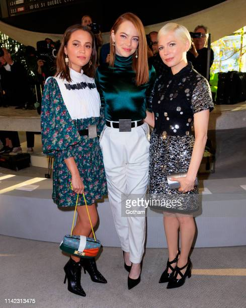 Alicia Vikander, Emma Stone and Michelle Williams at Louis Vuitton Cruise 2020 Fashion Show on May 8, 2019 in New York City.