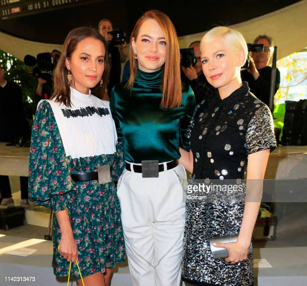Alicia Vikander, Emma Stone, Michelle Williams at Louis Vuitton Cruise 2020 Fashion Show on May 8, 2019 in New York City.