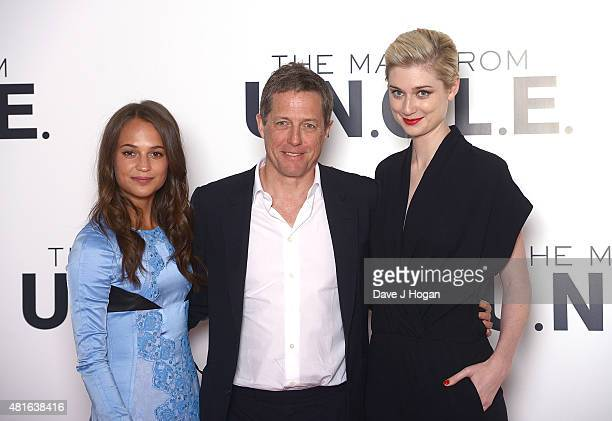 REQUIRED Alicia Vikander Hugh Grant and Elizabeth Debicki attend 'The Man from UNCLE' photocall at Claridge's Hotel on July 23 2015 in London England